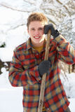 Young man clearing snow Stock Image