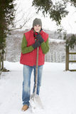 Young Man Clearing Snow From Drive Stock Photography