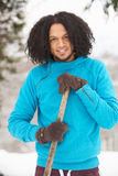 Young Man Clearing Snow From Drive Royalty Free Stock Image