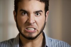 Young Man with Clenched Teeth Royalty Free Stock Images