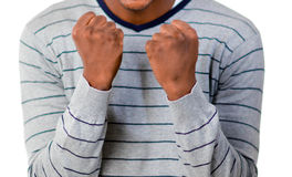 Young man clenching the fists. Successful man clenching the fists Stock Photography