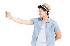 Young man clicking a selfie Royalty Free Stock Images