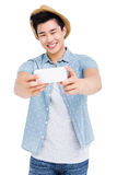 Young man clicking a selfie Royalty Free Stock Photo