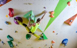 Young man climbing bouldering route Royalty Free Stock Photos