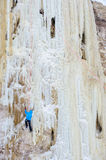 Young man climbing the ice Royalty Free Stock Photography