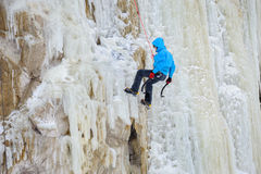 Young man climbing the ice Royalty Free Stock Images