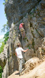 Young man climbing Stock Photo
