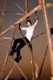 young man climbing on metal construction Stock Photography