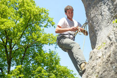 Young man climbing Stock Image
