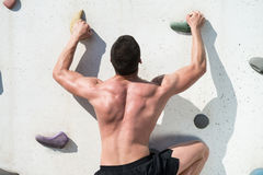 Young Man Climbing A Rock Wall Stock Images