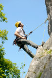 Young man climbing a rock wall Royalty Free Stock Image