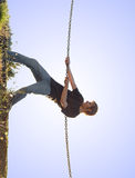 Young man climbing up Royalty Free Stock Photo