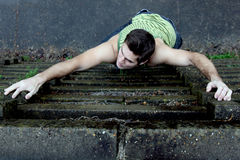 Young man climbing Royalty Free Stock Photos