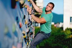 young man climbing wall rock outdoors Royalty Free Stock Photography