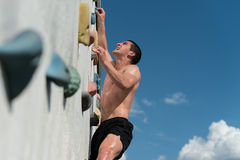 Young Man Climbing Wall Rock Outdoors Stock Photography