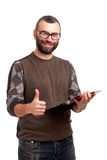 Young man with clipboard gesturing thumbs up Royalty Free Stock Photography