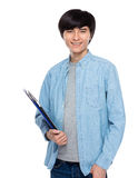 Young man with clipboard Royalty Free Stock Photo