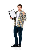 Young man with clipboard Royalty Free Stock Photography