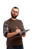 Young man with clipboard thinking Royalty Free Stock Photos