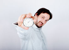 Young man with clock Royalty Free Stock Image