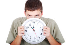 Young man with clock or watch Stock Photography