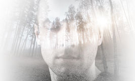 Young man with closed eyes combined with landscape. Young man, portrait with closed eyes combined with forest landscape, double exposure photo effect Royalty Free Stock Image