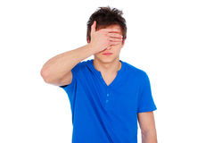Young man with closed eyes by hand Stock Photo