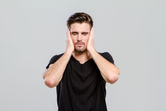 Young man closed his eyes and ears Stock Photo