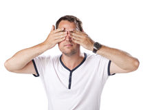 Young man closes his eyes hands Stock Images