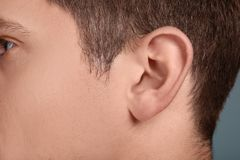 Young man, closeup of ear. Hearing problem royalty free stock photography
