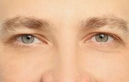 Young man, closeup of eyes stock image