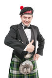 Young man in clothing for Scottish dance showing thumbs up Royalty Free Stock Image