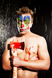 Young man in clown makeup. In the studio on a black background Stock Photos