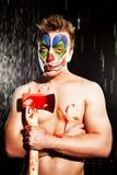 Young man in clown makeup Stock Photos