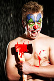 Young man in clown makeup. In the studio on a black background Royalty Free Stock Photos