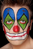 Young man in clown makeup Stock Photos
