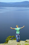The young man on coast of beautiful lake. Royalty Free Stock Photos