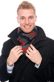 Young man with coat Royalty Free Stock Photography