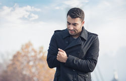 Young man in a coat Stock Photo