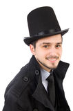 The young man in coat and hat isolated on white Royalty Free Stock Photography