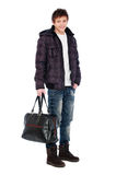 Young man in coat holding bag Stock Images