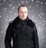 Young man in coat Stock Photography