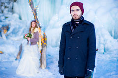 The young man in a coat in the winter Royalty Free Stock Photography