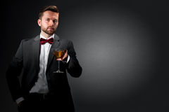 Young man with a cocktail glass Royalty Free Stock Photography