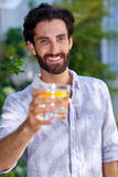Young man cocktail portrait Stock Image