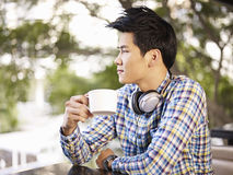 Young man in coffee shop Royalty Free Stock Image