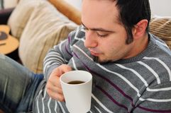 Young man with coffee or tea Royalty Free Stock Images