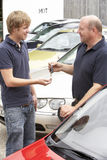 Young man collecting new car Royalty Free Stock Images