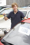 Young man collecting new car Stock Image