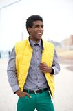 Young man in colorful clothing standing outdoors Royalty Free Stock Photography